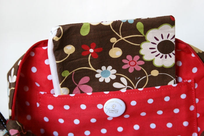 Large Box Bag detail featuring inside pocket, and included matching zippered pouch.