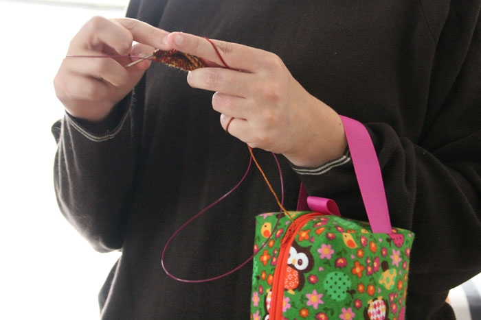 Wrist strap lets you knit while standing.